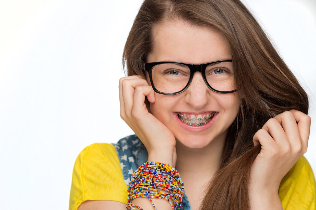 teen with glasses and braces